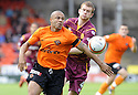 19/09/2009  Copyright  Pic : James Stewart.sct_jspa_19_dundee_utd_v_motherwell  .DANNY CADAMARTERI GETS AWAY FROM MARK REYNOLDS.James Stewart Photography 19 Carronlea Drive, Falkirk. FK2 8DN      Vat Reg No. 607 6932 25.Telephone      : +44 (0)1324 570291 .Mobile              : +44 (0)7721 416997.E-mail  :  jim@jspa.co.uk.If you require further information then contact Jim Stewart on any of the numbers above.........