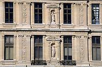 Sculpted facade of the Louvre Museum, Paris, France.