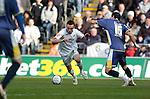 Coca-Cola Football League Championship - Swansea City v Cardiff City @ The Liberty Stadium in Swansea..Swansea's Leon Britton takes on Joe Ledley of Cardiff..