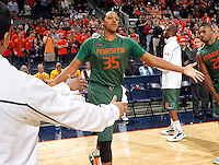 CHARLOTTESVILLE, VA- JANUARY 7: Kenny Kadji #35 of the Miami Hurricanes runs through the huddle during the game against the Virginia Cavaliers on January 7, 2012 at the John Paul Jones Arena in Charlottesville, Virginia. Virginia defeated Miami 52-51. (Photo by Andrew Shurtleff/Getty Images) *** Local Caption *** Kenny Kadji