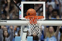 CHAPEL HILL, NC - FEBRUARY 1: The basketball drops through the hoop during a game between Boston College and North Carolina at Dean E. Smith Center on February 1, 2020 in Chapel Hill, North Carolina.