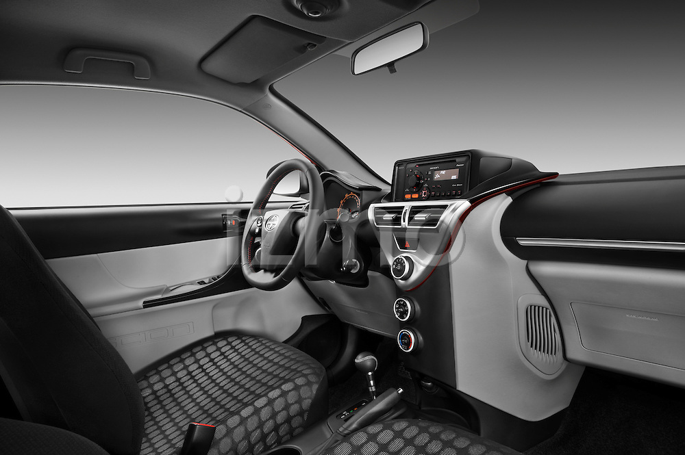Passenger side dashboard view of a 2012 Scion IQ.