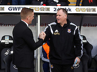 Pictured L-R: Swansea manager Garry Monk greets the West Ham stand-in manager  Saturday 10 January 2015<br /> Re: Barclays Premier League, Swansea City FC v West Ham United at the Liberty Stadium, south Wales, UK