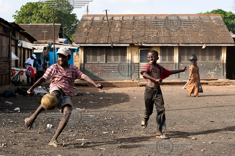 Children play a game of football in a rare patch of open ground in Agbogbloshie, a slum district of Accra.