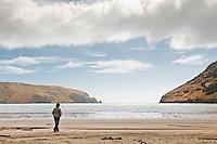 Woman on a beach at Le Bons Bay near Akaroa - Banks Peninsula, East Coast, South Island, New Zealand