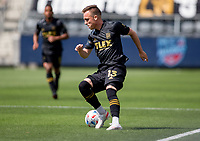 LOS ANGELES, CA - APRIL 17: Corey Baird #13 of LAFC moves with the ball during a game between Austin FC and Los Angeles FC at Banc of California Stadium on April 17, 2021 in Los Angeles, California.