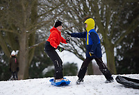 Two young boys having fun in the park on their sledges following Heavy Snowfall at Sidcup, Kent, England on the 8 February 2021. Photo by Alan Stanford.