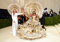 """Harris Reed, left, and Iman attend The Metropolitan Museum of Art's Costume Institute benefit gala celebrating the opening of the """"In America: A Lexicon of Fashion"""" exhibition on Monday, Sept. 13, 2021, in New York. (Photo by Evan Agostini/Invision/AP)"""