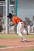 San Francisco Giants shortstop Manuel Geraldo (26) starts towards first base after laying down a bunt during an Instructional League game against the Kansas City Royals at the Giants Training Complex on October 17, 2017 in Scottsdale, Arizona. (Zachary Lucy/Four Seam Images)