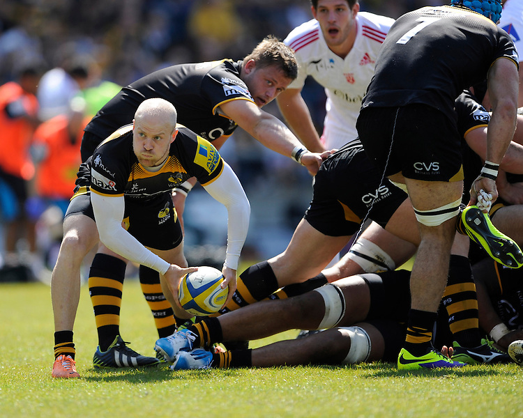 Joe Simpson of London Wasps passes during the first leg of the European Rugby Champions Cup play-off match between London Wasps and Stade Francais at Adams Park on Sunday 18th May 2014 (Photo by Rob Munro)