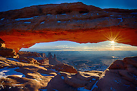 Mesa Arch Sunrise. Mesa Arch is one of the most photographed locations in Canyonlands National Park near Moab. Most western landscape shooters have this on their shot list or already in the bag. In many classic images of this event, you will notice the sun positioned to the left side of the arch. I wanted to shoot this close to the Winter Solstice when the sun was far to the south and did so on December 27, 2012. Standing alongside my son, J.C. Lansche, on a 5 degree morning made it special. This was the the beginning of a 5 day winter camping trip with J.C. through the desert southwest..