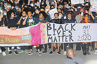 """Thousands gathered in Boston Common in Boston, Massachusetts, on Sun., May 31, 2020, to demonstrate against police brutality after the killing by police of George Floyd in Minneapolis, Minnesota, the previous week. Protests, sometimes violent, have erupted around the United States. This protest was organized by an organization called Black Boston. Protesters often chanted """"Black Lives Matter"""" and """"Fuck the police."""" The protest began at 6:30pm in various parts of the city, and around 9pm, after most protesters had left, there began to be clashes between people and police, especially in the Downtown Crossing area of Boston and around Boston Common."""