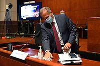United States Representative David Cicilline (Democrat of Rhode Island), wipes down his desk before the start of a House Judiciary Committee hearing on Capitol Hill in Washington, Wednesday, June 24, 2020, on oversight of the Justice Department and a probe into the politicization of the department under Attorney General William Barr. Former Attorney General Michael Mukasey, front left, waits to testify. <br /> Credit: Susan Walsh / Pool via CNP/AdMedia