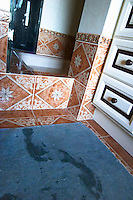 In the bathroom, wet foot steps on the blue bathroom mat outside the shower cabin Clos des Iles Chambres d'Hotes Bed and Breakfast Le Brusc Six Fours Cote d'Azur Var France