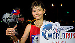 Female winner 培 簡 of Taiwan poses with the trophy at the Wings for Life World Run on May 2, 2015 in Yi-Lan, Taiwan. Photo by Victor Fraile / Power Sport Images