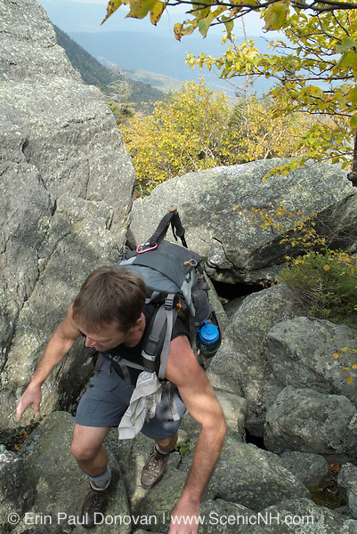 Hiking on the King Ravine Trail during the early autumn months. Located in the White Mountains, New Hampshire USA. ..Notes: