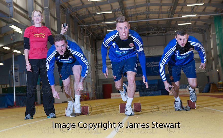 Scots Athlete Eilidh Child takes Hearts' players Dale Carrick, Kevin McHattie and Jack Hamilton through their paces at Grangemouth Stadium.