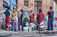Bhaktapur, Nepal.  Women Filling their Water Pots at a Public water Tap.