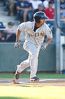 Marcos Derkes #19 of the Tri-City Dust Devils hustles down the first base line during a game against the Everett AquaSox at Everett Memorial Stadium in Everett, Washington on July 28, 2014. Tri-City defeated Everett 6-5 in 11 innings.  (Ronnie Allen/Four Seam Images)