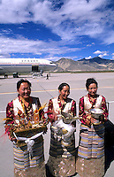 Woman in traditional clothes with welcome silk at airport in capital city of Lhasa Tibet, China