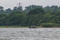 BNPS.co.uk (01202 558833)<br /> Pic: MaxWillcock/BNPS<br /> Date taken: 27/06/2021<br /> <br /> Pictured: Police boats.<br /> <br /> The search for a heroic teenager who is feared to have drowned after rescuing his nieces and nephews from a ferocious riptide is continuing today.<br /> <br /> Calum Osborne-Ward, 18, was swept away in front of his family moments after lifting the last of a group of children into a rescue boat.<br /> <br /> The youngsters had been swimming and playing in relatively shallow water close to Black Bridge at Rockley Point in Poole Harbour, Dorset, when they were dragged away by the fast flowing tide.