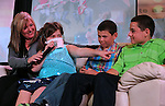 2012 wish recipient Gabby Gouldsmith talks at the Make-A-Wish Waffles & Wishes event at the Atlantis Casino Resort Spa in Reno, Nev., on Tuesday, March 26, 2013. Her mom, Heather, and brothers Gunner and Garrett talked about the impact Gabby's wish had on the family..Photo by Cathleen Allison