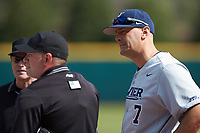 Xavier Musketeers head coach Scott Googins talks with the umpires before the game against the Penn State Nittany Lions at Coleman Field at the USA Baseball National Training Center on February 25, 2017 in Cary, North Carolina. The Musketeers defeated the Nittany Lions 10-4 in game one of a double header. (Brian Westerholt/Four Seam Images)