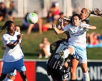 Allie Long #9 of the Washington Freedom sends the ball away from Formiga #8 and Karen Carney #14 of the Chicago Red Stars during a WPS match on July 4 2010 at the Maryland Soccerplex, in Boyds, Maryland. The match ended in a 0-0 tie.