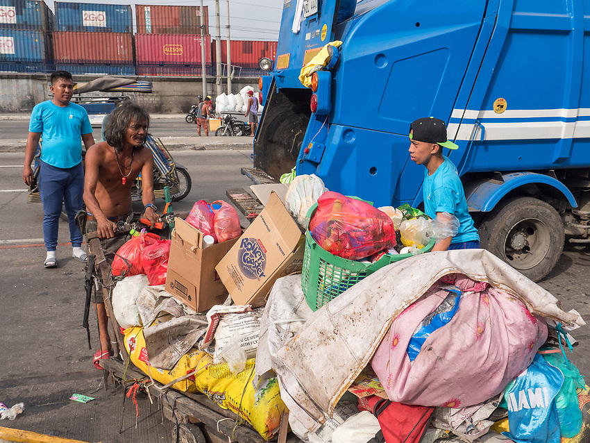 Garbage Truck. Slum area near North Harbour poverty and recycling of plastic, Manila, Philippines