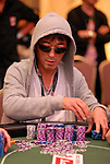 Yoshihiro Tasaka hauls in chips after taking the chip lead in level 10