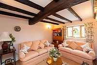 BNPS.co.uk (01202 558833)<br /> Pic: Savills/BNPS<br /> <br /> Pictured: A lounge space with visible wooden beams in the ceiling.<br /> <br /> A historic thatched home where Cromwell's army stayed during the English Civil War is on the market for £1.6m.<br /> <br /> The Barracks, so-named for its links with Cromwell more than 370 years ago, has spectacular country views and is in one of Cheshire's most popular areas.<br /> <br /> The five-bedroom property just outside the picturesque village of Bunbury is a far cry from how it would have looked in Cromwell's time, having been extended over the years.<br /> <br /> It was used in the 17th century by Cromwell's armies during the siege of Beeston Castle - two miles away. The castle's location made it valuable to both the royalists and parliamentarians.