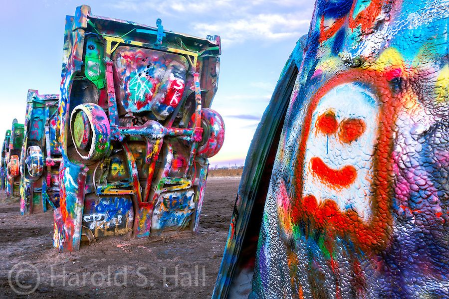Along Route 66 west of Amarillo, Texas, Cadillac Ranch was construed and erected by a group of artistic hippies from San Francisco back in 1974. They called themselves The Ant Farm.  Ten Cadillacs from the 1949 Club Sedan to the 1963 Sedan de Ville and their now vandalized tail fins point to the sky. The smell of spray paint is detected from 100 yards away. I visited this iconic art work on two successive mornings.  What was spray painted and visible one morning was painted over with new art the next.  Forty years of spray painting has built up the layers and layers of paint to over an inch in many places.  Bring your paint and have some fun.