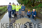 Concerned residents in Glandahalin in Ballyheigue show the condition of the potholes and the state of their road on Monday. <br /> Kneeling Kathleen Behan and Michael Casey<br /> Back l to r: John Reidy, Tim Walsh, Francie Gentleman, Paddy Brennan, Thomas Harrington and Pat O'Hara.
