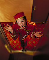 "Hotel bellhop throwing up his hands in exasperation, as if he is saying """"I don't know where your luggage is"""". Billboard and broadcast must be negotiated, due to talent agreement. Bellhop. United States Hotel."