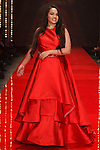 walks runway in a red dress by Mac Duggal, for the Red Dress Collection 2017 fashion show, for The American Heart Association, presented by Macy's at the Hammerstein Ballroom in New York City on February 9, 2017; during New York Fashion Week Fall 2017.