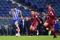 30th April 2021; Dragao Stadium, Porto, Portugal; Portuguese Championship 2020/2021, FC Porto versus Famalicao; Marko Grujic of FC Porto beats Gustavo Assunção of Famalicao
