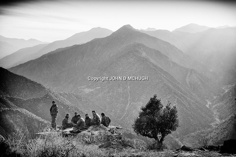 Afghan National Army soldiers are seen at Observation Post Mace, near Gowerdesh in northern Kunar, 20 November 2011. (John D McHugh)