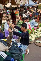 Myanmar, Burma, Mandalay.  Cauliflower and Used Clothing for Sale on the Street Market.