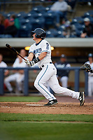 West Michigan Whitecaps catcher Austin Athmann (25) follows through on a swing during a game against the Clinton LumberKings on May 3, 2017 at Fifth Third Ballpark in Comstock Park, Michigan.  West Michigan defeated Clinton 3-2.  (Mike Janes/Four Seam Images)