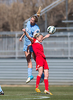 Ingrid Wells (9) of the Washington Spirit goes up for a header with Kelly McFarlane (11) of the North Carolina Tar Heels  during the game at the Maryland SportsPlex in Boyds, MD.  The Washington Spirit defeated the North Carolina Tar Heels in a preseason exhibition, 2-0.