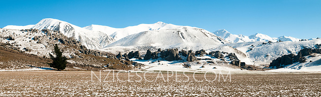 Farmland at Castle Hill rock formations in winter, Canterbury, South Island, New Zealand, NZ