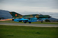 MiG-21 F of the 95th Air Force Base from the Romanian Air Force takes off with afterburner. BOLD AVENGER 2007 (BAR 07), a NATO  air exercise at Ørland Main Air Station, Norway. BAR 07 involved air forces from 13 NATO member nations: Belgium, Canada, the Czech Republic, France, Germany, Greece, Norway, Poland, Romania, Spain, Turkey, the United Kingdom and the United States of America..The exercise was designed to provide training for units in tactical air operations, involving over 100 aircraft, including combat, tanker and airborne early warning aircraft and about 1,450 personnel.