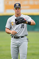 Aaron Judge (35) of the Charleston RiverDogs warms up in the outfield prior to the game against the Hickory Crawdads at L.P. Frans Stadium on May 25, 2014 in Hickory, North Carolina.  The RiverDogs defeated the Crawdads 17-10.  (Brian Westerholt/Four Seam Images)