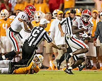 KNOXVILLE, TN - OCTOBER 5: Tae Crowder #30 of the Georgia Bulldogs runs for a touchdown after a fumble during a game between University of Georgia Bulldogs and University of Tennessee Volunteers at Neyland Stadium on October 5, 2019 in Knoxville, Tennessee.