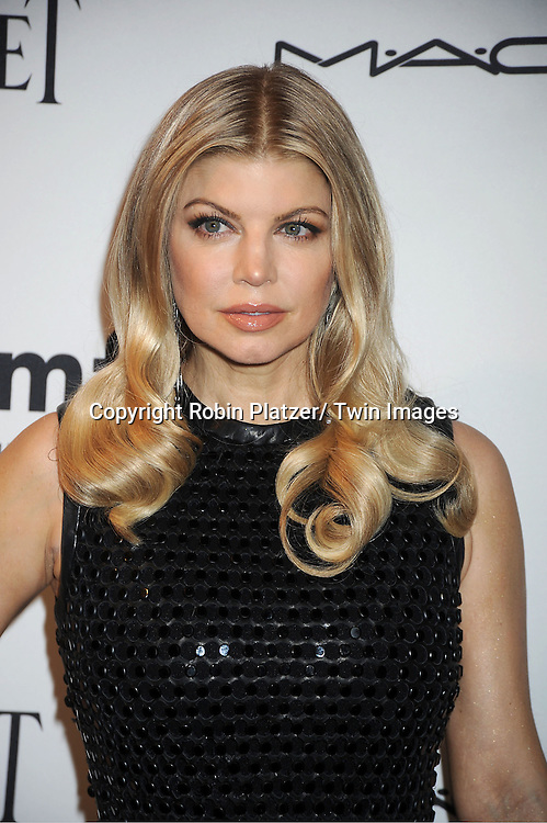 Fergie in Calvin Klein Collection black dress attends the amfAR Inspiration Gala on June 7, 2012 at The New YOrk Public Library in New York City. The honorees were Fergie and Robert Duffy/ Marc Jacobhs International and the Scissor Sisters performed.