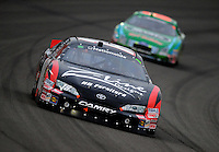 Feb 21, 2009; Fontana, CA, USA; NASCAR Nationwide Series driver Kyle Busch leads Carl Edwards during the Stater Brothers 300 at Auto Club Speedway. Mandatory Credit: Mark J. Rebilas-
