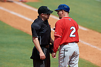 Lakewood BlueClaws manager Marty Malloy (2) argues a call with home plate umpire John Budka during a game against the Greensboro Grasshoppers on June 10, 2018 at First National Bank Field in Greensboro, North Carolina.  Lakewood defeated Greensboro 2-0.  (Mike Janes/Four Seam Images)