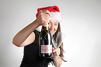 Christmas-woman with champagne bottle