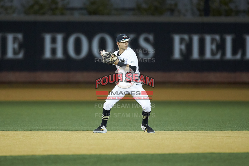 Wake Forest Demon Deacons shortstop Patrick Frick (5) makes a throw to first base against the North Carolina State Wolfpack at David F. Couch Ballpark on April 18, 2019 in  Winston-Salem, North Carolina. The Demon Deacons defeated the Wolfpack 7-3. (Brian Westerholt/Four Seam Images)