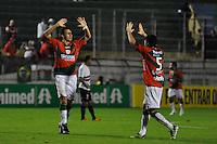 SÃO PAULO, SP, 23 DE JUNHO DE 2012 - CAMPEONATO BRASILEIRO - PORTUGUESA x SÃO PAULO:  Gustavo (e) e Lima (d) comemoram gol da Portuguesa durante partida Portuguesa x São Paulo, válida pela 6ª rodada do Campeonato Brasileiro de 2012 no Estádio do Canindé. FOTO: LEVI BIANCO - BRAZIL PHOTO PRESS